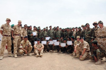 British Army Engineers pictured with their Afghan National Army students, holding certificates