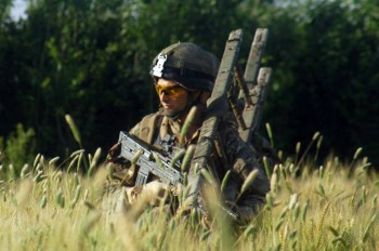 """Lance Corporal John Zoumides on patrol in Sangin's """"Green Zone"""""""