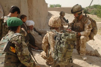 Me and my interpreter talking to locals on patrol in the backstreets of Sangin