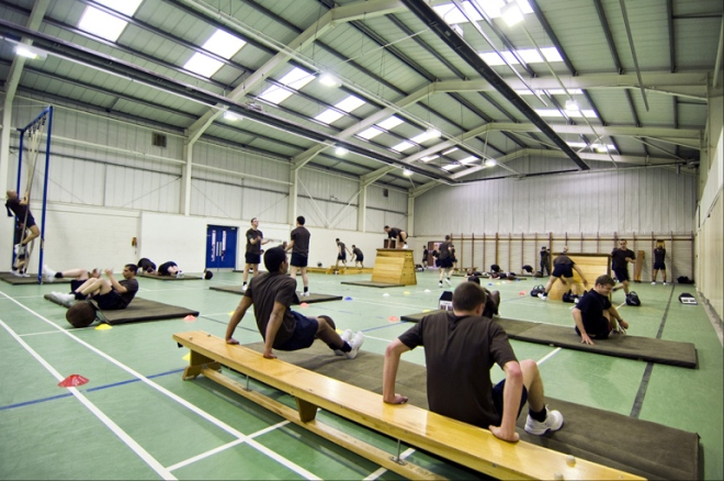 Soldiers under Training (SuTs) work hard on their fitness in one of the three gym halls at ATC Pirbright.