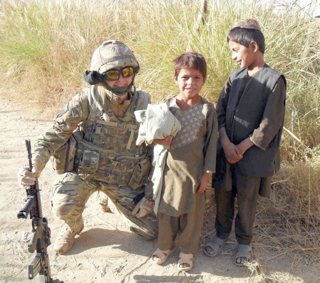 Captain Lisa Irwin pictured with local Afghan boys