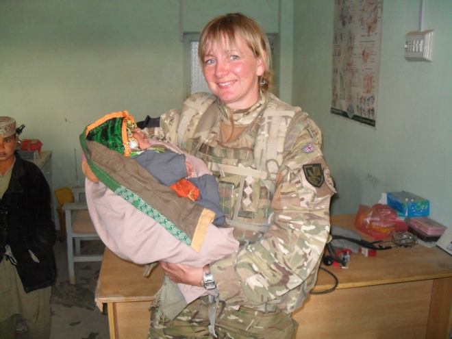 Captain Lisa Irwin with an Afghan baby