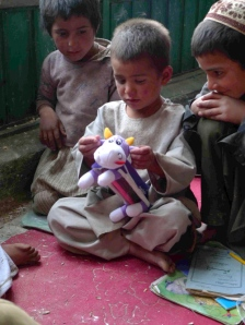 An Afghan boy examines a gift from the UK