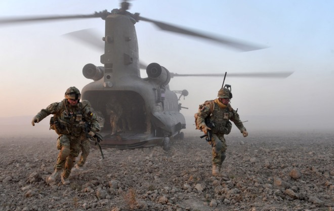 Troops disembarking a Chinook helicopter