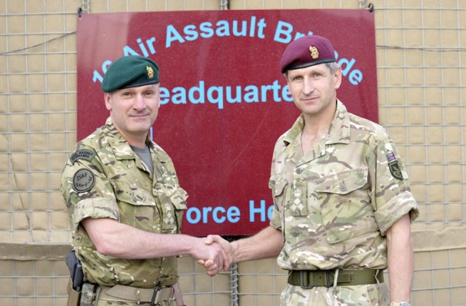Brigadier James Chiswell of 16 Air Assault Brigade hands over authority of Task Force Helmand HQ to Brigadier Ed Davis of 3 Commando Brigade in Lashkar Gah.