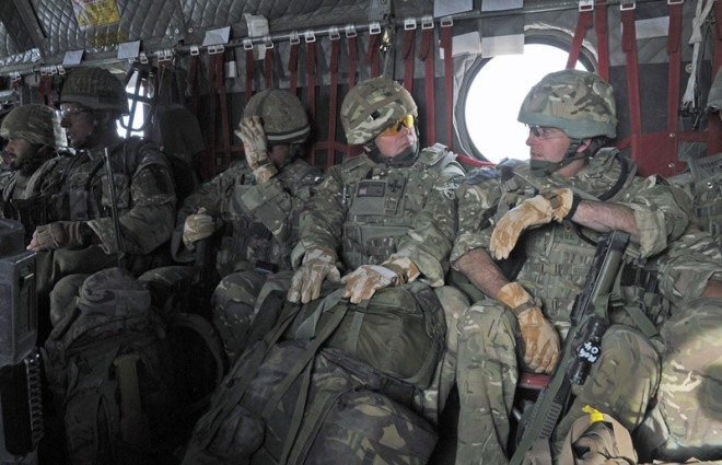 Lieutenant Colonel Tim Purbrick (right) with Padre Ian Wheatley extracting from the Green Zone in an RAF Chinook with B Coy, 2 PARA