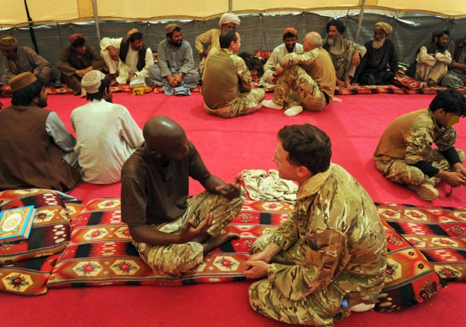 Lieutenant Colonel Tim Purbrick and Private Omar Darboe at the Koran sharif in the Green Zone