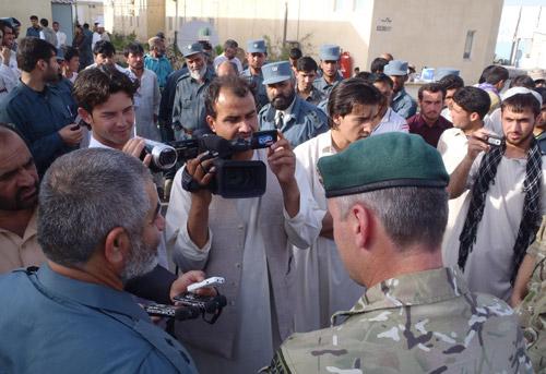 General Hakeem Angar and Brigadier Ed Davis talk to the media at Police Headquarters in Lashkar Gah