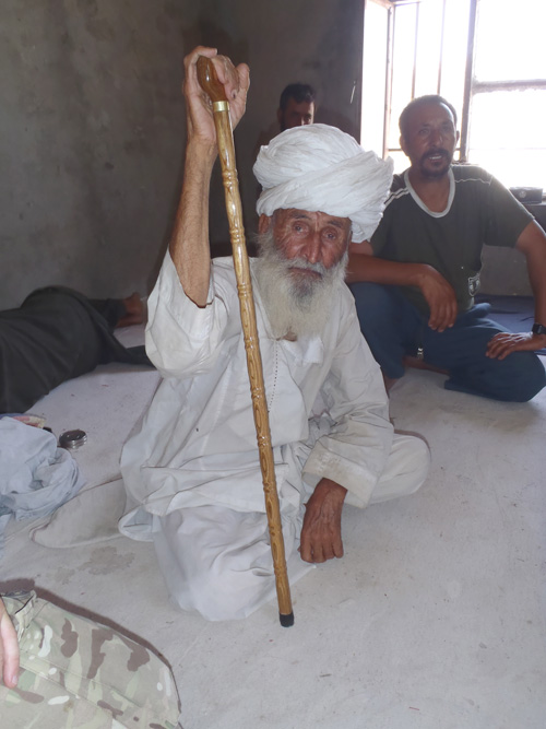 The 'oldest man in Helmand' is given a new walking stick by A Company 4 SCOTS at Check Point 1, east of Lashkar Gah.