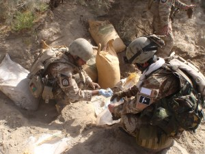 Two Bost 170 operators take chemical samples from the largest find ever made in Helmand
