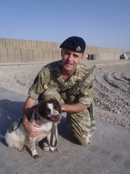 Lt Col Tim Purbrick takes Misty the search dog for a morning walk in Lashkar Gah