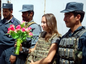The Sun's Defence Editor, Virginia Wheeler, is presented with flowers at Precinct 2 Police HQ in central Lashkar Gah.