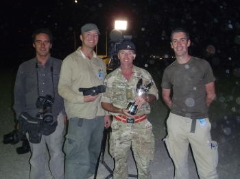 Rowan Griffiths (Daily Mirror), Charlie Kinross (ITV), Lt Col Tim Purbrick with the Pride of Britain Award, and Matthew Hinchcliffe (ITV) at the Awards ceremony in Camp Bastion.