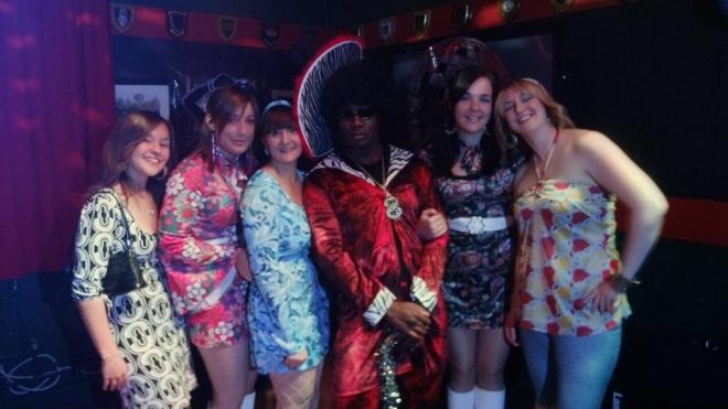 Musn Peacock, Musn Baggott, Musn Grifths, Musn Neat, Musn Hughes and LCpl Martin on the dance floor at the '70s night