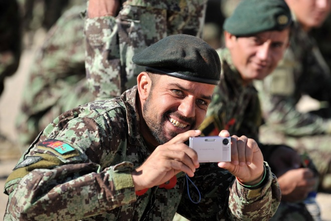 An Afghan soldier photographs the photographer.