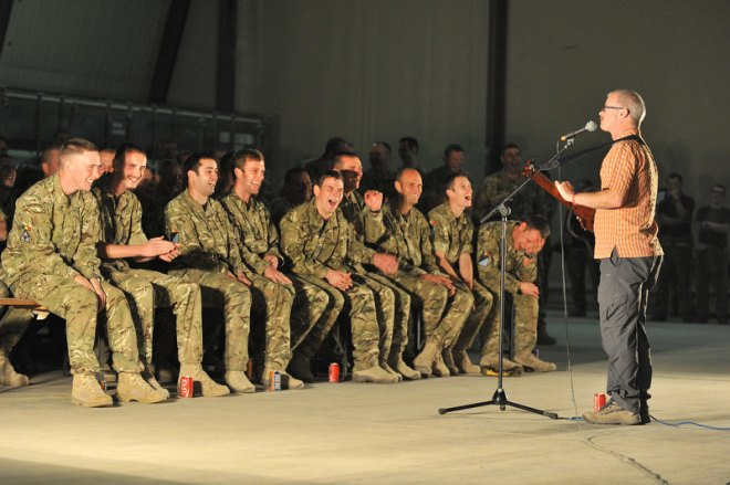 A comedian entertains the troops.