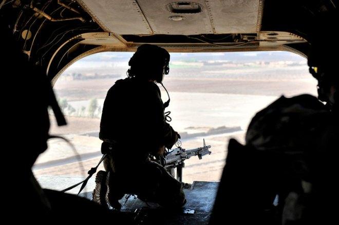The ever watchful door gunner on the Chinook