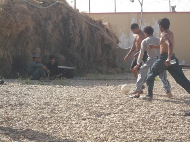 Police advisory team playing football with AUP inside Paind Kalay Police station