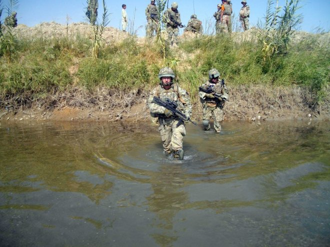 LCpl Jallow and 2Lt Laybourne cross a river during Op Tora Ghar 9.