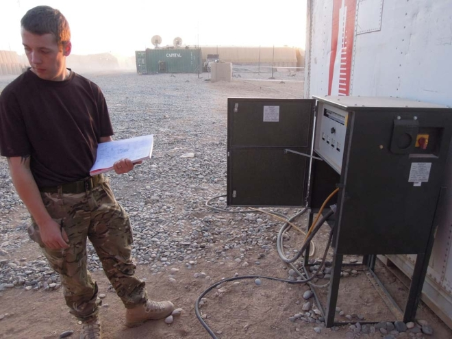 LCpl Andrews and LCpl Simpson inspect a number of power distribution systems