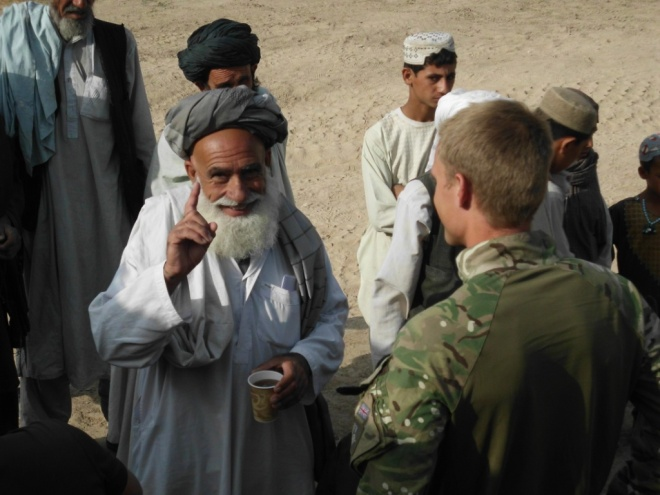 Lt Jamie Frampton with local nationals in Nad-e-Ali