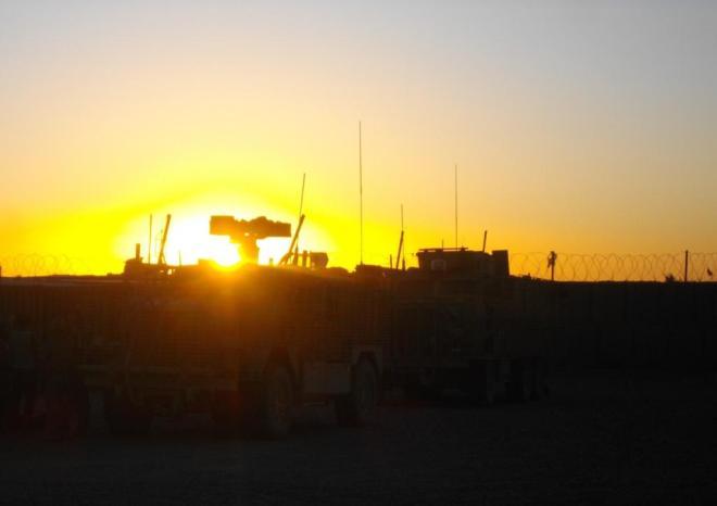Sun setting over C Company's vehicles in Nad-e-Ali