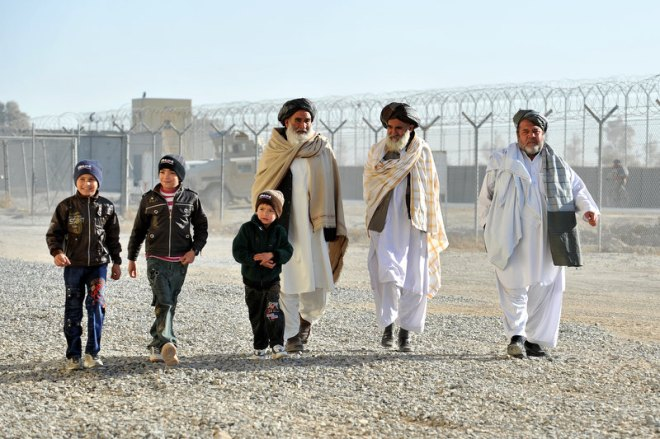 A small group of Afghans arrive at the Kandahar Air Wing (KAW)