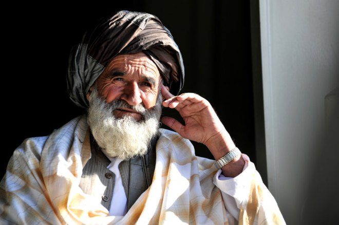 An Afghan elder enjoys some shade