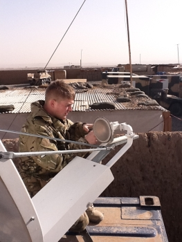 LCpl Attwood conducting equipment care on a VSAT