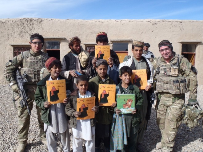 , Pte Chiverton and Sgt Shinner (RAF Regiment) with the children of the Khorgajat School.