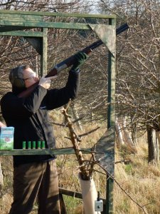 A band member shooting clay pigeons