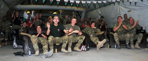 Soldiers from all around Wales have returned from operations on the front line to support their rugby team while in Afghanistan.