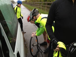A puncture threatens to set the team back, but they were soon on the road again.