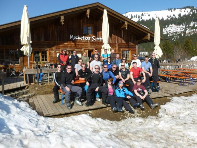 The skiing group surrounded by snow.