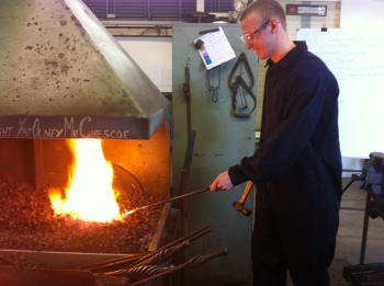Metal working techniques - heating metal in the furnace.