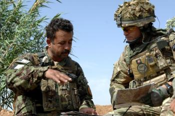 A British Officer mentors his Afghan counterpart