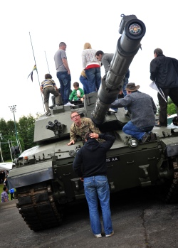 Families and friends get up close and personal with a Challenger II main battle tank on the Dettingen weekend in June.