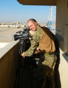 Cpl Mike Hubbard filming in Lashkar Gah