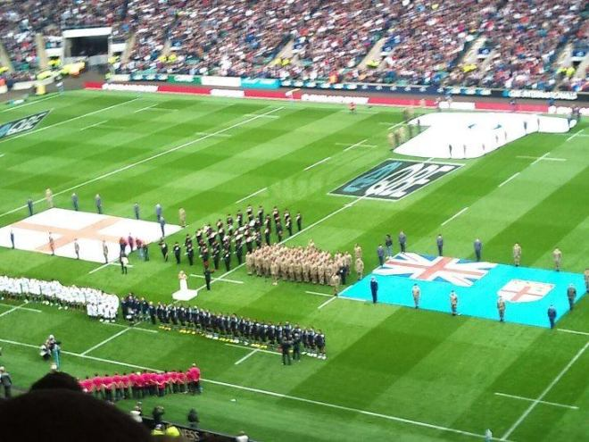 The Band and Bugles of The Rifles and The Rifles Fijian Choir on the ground at Twickenham stadium.