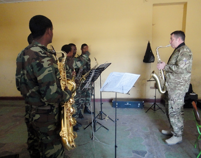 Sgt Innes giving saxophone lessons.