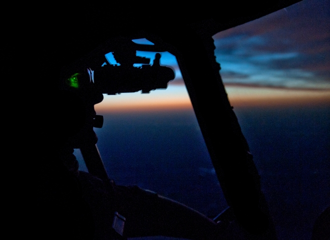 Flying into dawn – my co-pilot uses Night Vision Goggles to aid in flying before the sun rises over the Helmand Desert
