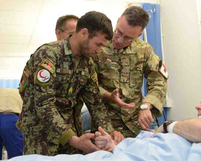 ISAF are teaching the afghan doctors and surgeons more advanced medical techniques to enable them to look after and care for the more seriously injured soldiers. Sgt Barry Pope RLC (Phot)