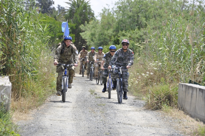 The Force Commander UNFICYP, Maj General Chao Liu on a bike patrol with Cpl Jamie Dougall 17 Port and Maritime Grp  S/Sgt R Chovanec  Slovakian Army