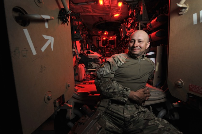 WO2 Grant Turley (41), Squadron Sergeant Major of 32 Squadron, Combat Logistic Support Regiment  relaxes on the steps of his Mastiff vehicle during a break in the Combat Logistic Patrol.