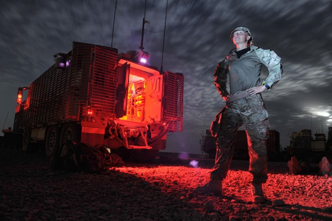 Corporal Sheridan Lucas (27), part of 3 Combat Support Logistic Regiment prepares to wake soldiers who have been given a two hour enforced rest during a Combat Logistic Patrol.