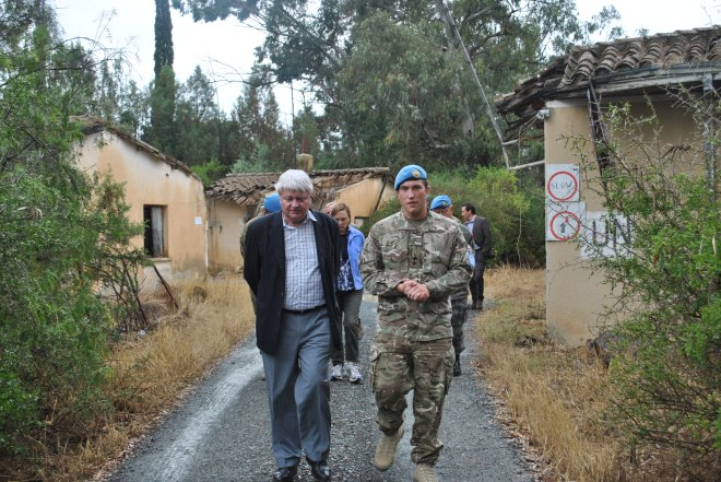 Lt Tom Murphy escorts Mr Ladsous, UN Under-Secretary General for Peacekeeping Operations on a tour of the Buffer Zone. Capt Singlehurst RE
