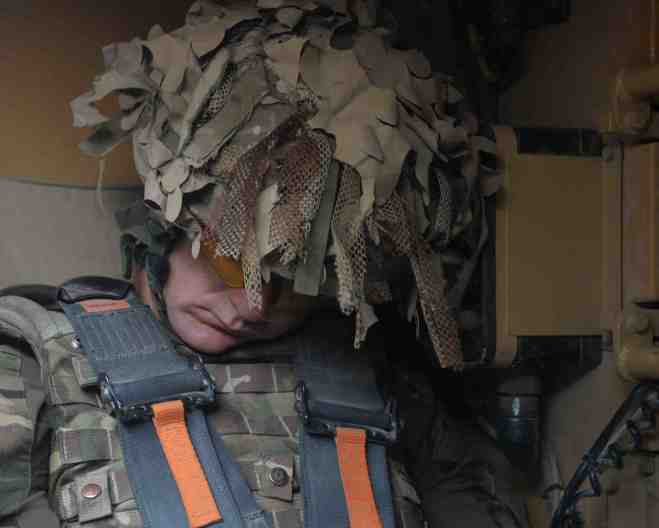 Capt Mau Gris recharges his batteries before the operation. By Sgt Barry Pope RLC (phot)