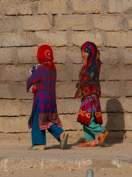 Two brightly coloured Afghan girls