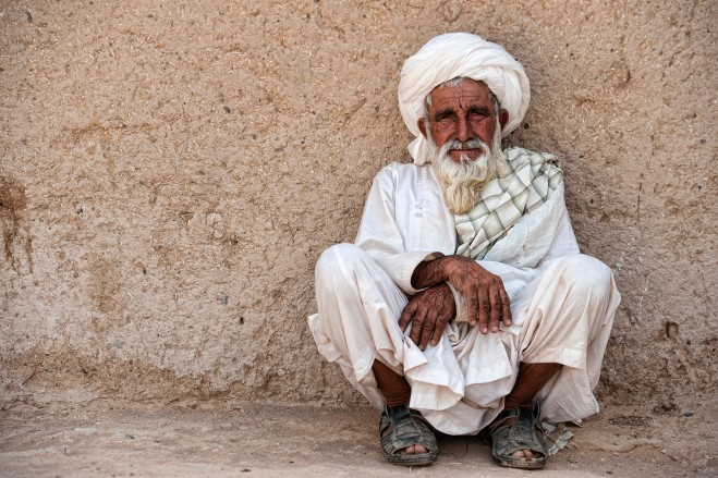 An Afghan elder poses for a picture.