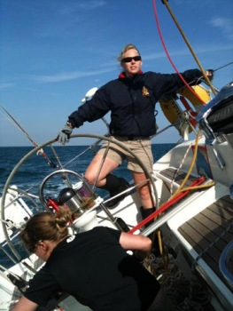 Enjoying the sunshine in the Solent – Lucie at the helm.